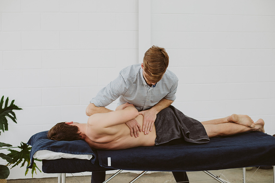 Osteopath treating back pain